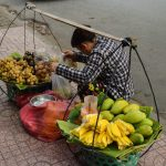 A woman selling fruit in Ho Chi Minh City