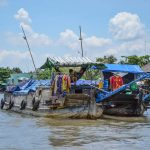 Family life on the boat in Mekong Delta