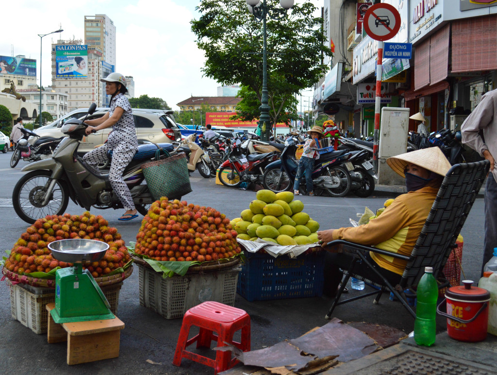 Fruit stall with mangos and rambutans