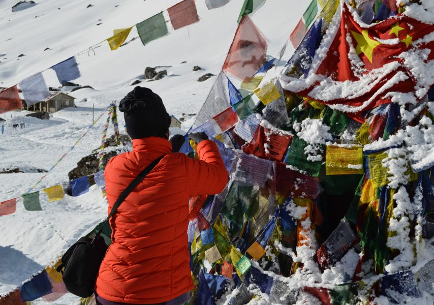 Attaching the prayer flags at ABC