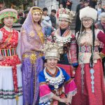 Chinese girls wearing ethnic costumes